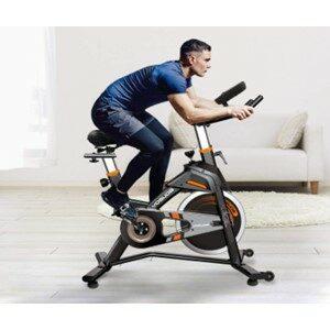 Man Riding Exercise Bike