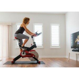 Women Riding Bike Watching TV